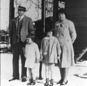 Photo taken about 1930 of Wilson Van Buren Taylor, his wife Passie Louisa Witt, and their two daughters Mildred Louise Taylor and Virginia Van Taylor. Photograph is believed to have been taken outside their temporary home in Mount Pleasant, Texas